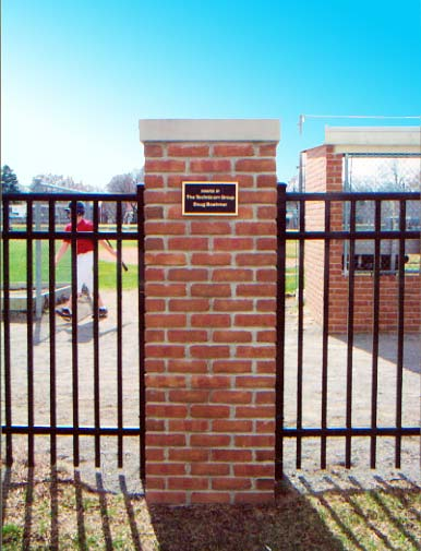 Brick pillars and fencing at Elworthy Field